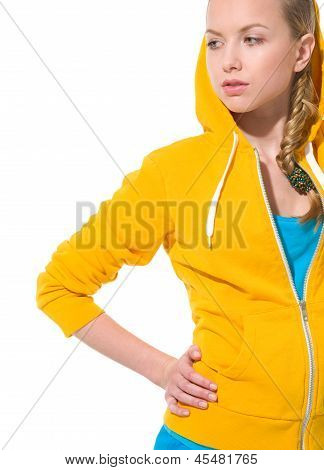 Modern Teenager Girl In Sweater With Draped Hood Looking On Copy Space