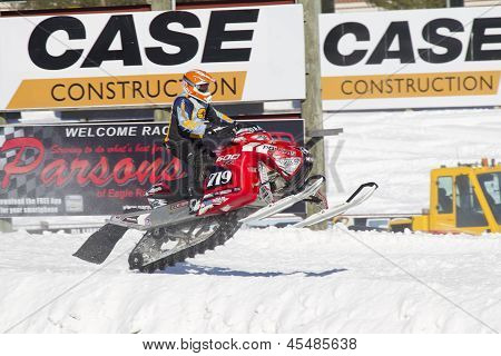 Red And Black Polaris Snowmobile Crashing Down