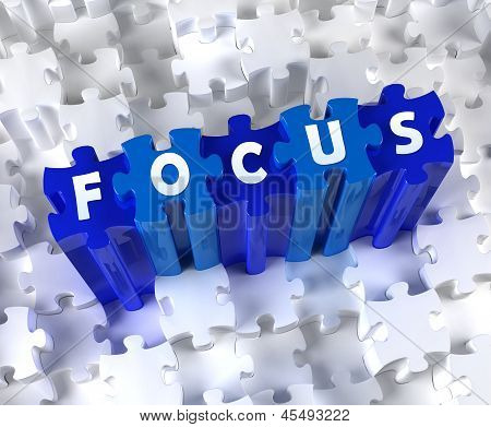 Creative 3D pieces of puzzle and word FOCUS