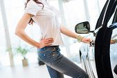 foto of showrooms  - woman opens the door to a new car - JPG