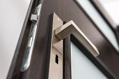 stock photo of keyhole  - Modern contemporary satin handle and keyhole detail - JPG