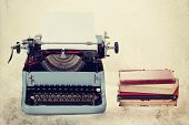 image of old vintage typewriter  - Old typewriter with paper and books retro colors on the desk - JPG