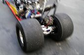 stock photo of dragster  - close up of dragster rear tires in motion - JPG