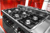 stock photo of oven  - Modern gas stove and oven in stainless steel - JPG