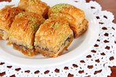 stock photo of baklava  - Sweet baklava on plate on table close - JPG