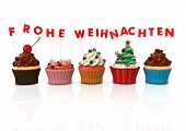 foto of weihnachten  - Colorful cupcakes with red german text Frohe Weihnachten translate Merry Christmas - JPG