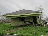 pic of katrina  - black x marks this house for demolition - JPG