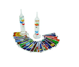 stock photo of galileo-thermometer  - Galileo Thermometer which uses the movement of precisely measured balls to determine the temperature with fortune telling cards used by Gypsies - JPG