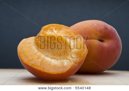 Fresh Apricot On Blue Background