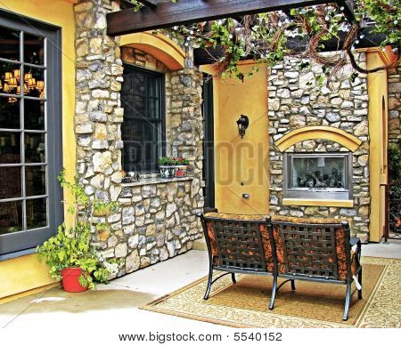 Tuscan Style Patio With Fireplace