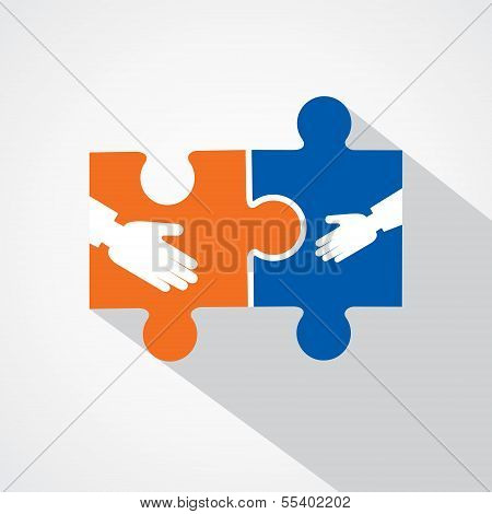 Businessman handshake with puzzle pieces
