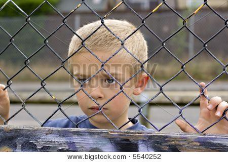Child Through Fence