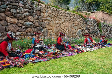 CUZCO, PERU - JULY 15: women selling handcraft in the Peruvian Andes at Cuzco Peru on July 15th, 2013. In the Andes of Peru every village has its own weaving patterns and traditions.
