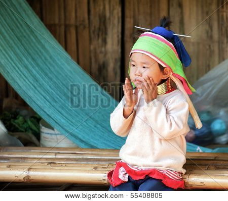 CHIANG RAI, THAILAND - DEC 4 : Unidentified long neck Mae Hong Son hill tribe minority girl in touristic village on December 4, 2013 in Chiang Rai, Thailand.