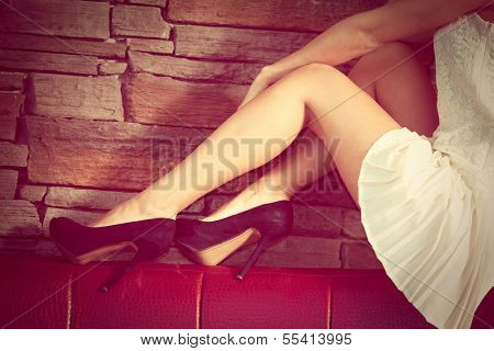 woman legs in high heel shoes indoor shot