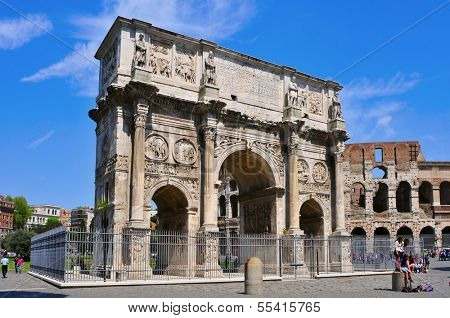 ROME, ITALY - APRIL 17: the Arch of Constantine and the Coliseum on April 17, 2013 in Rome, Italy. The Coliseum is an iconic symbol of Rome and one of the most popular tourist attractions in the citY