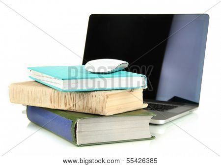 Computer mouse on books and notebook isolated on white