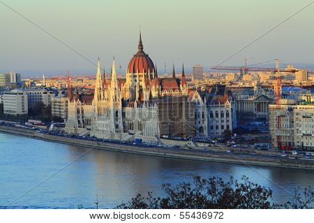 Hungarian Parliament Building On The Banks Of The Danube River In Budapest