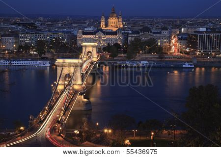 Night In Budapest With The Famous Chain Bridge Light Up With Traffic Crossing The Danube River