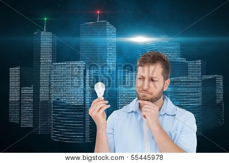 Composite image of sceptical model holding a bulb