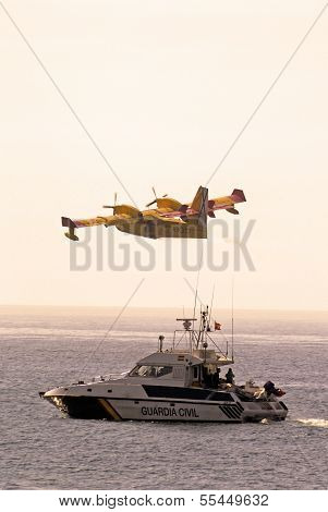 Fire bomber and Guardia Civil boat, Spain.