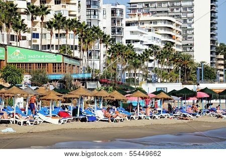 Crowded beach, Marbella, Spain.