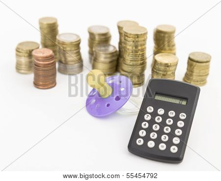 Pacifier With Hard Money And Pocket Calculator