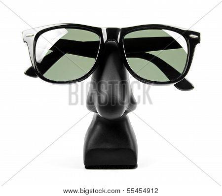 Black Sunglasses On Holder Isolated On White