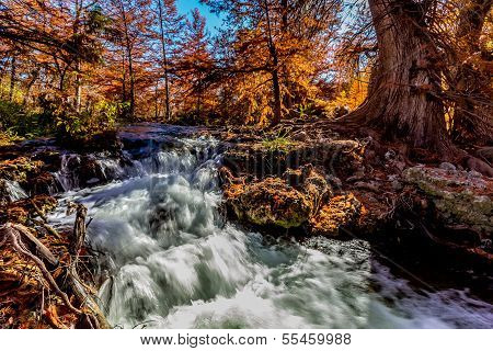 Beautiful Swift Clear Water with Waterfalls and Fall Foliage Surrounding the Guadalupe River Texas.