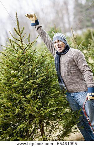 Man With Christmas Tree On A Farm