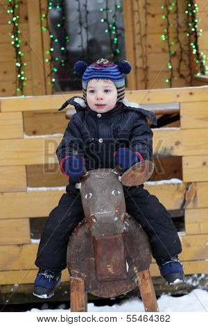 Boy On Wooden Cow