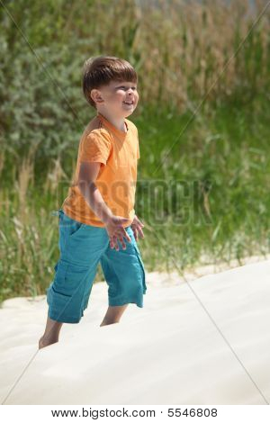 Boy Goes On Sand,  Side View
