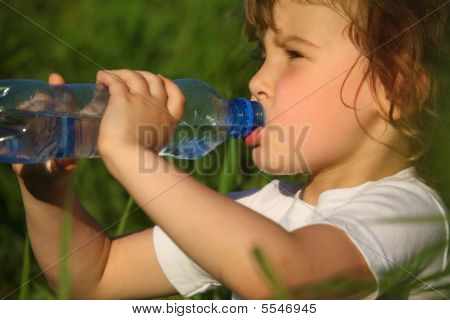 Closeup Portrait Of Drinking Girl In Grass