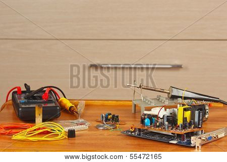 Workplace tools and parts of electronics repairman