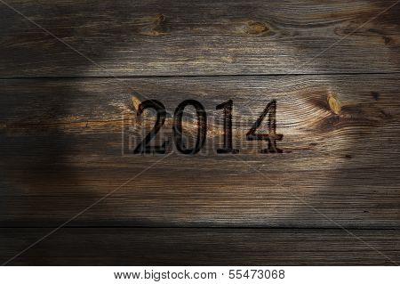 Old plank of spent inscription 2014, New Year.