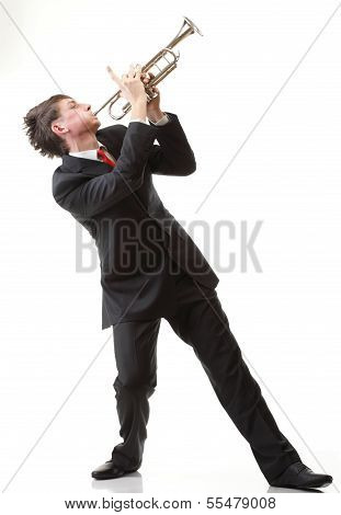 Portrait Of A Young Man Playing His Trumpet Plays Isolated White