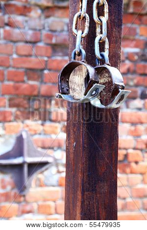 Fetters, Manacles On Brick Background