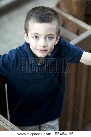 Handsome Young Boy Portrait In A Park
