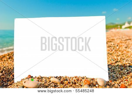 White Blank Sheet Of Paper On The Beach