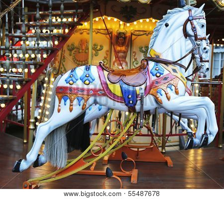 Horses on a traditional fairground carousel in Avignon, France