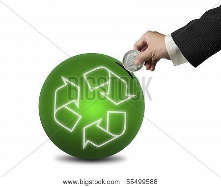 Hand Hold Coin Insert Into Ball With Recyling Symbol , Isolated