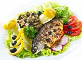 pic of gold tooth  - Grilled trout with lime and salad isolated on white - JPG