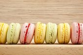 Tasty colorful macaroon on a wooden background