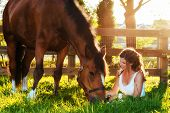 image of bay horse  - horse and woman in pasture - JPG