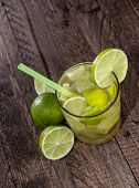 Glass With Caipirinha On Wood