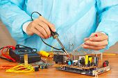 Master solder electronic components of device in service workshop