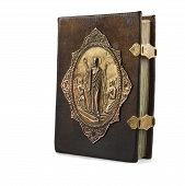 stock photo of leather-bound  - Old Orthodox Gospel bound in leather on a white background - JPG