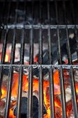 stock photo of charcoal  - Hot BBQ Grate And Burning Charcoal - JPG