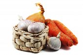 Garlic In A Small Wicker Basket, Carrots And Onions