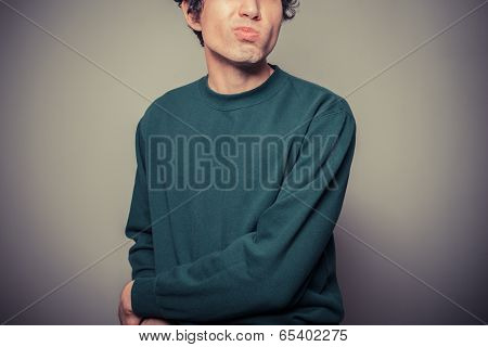Young Man Pulling Silly Faces